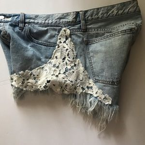 Free People distressed jean shorts 31